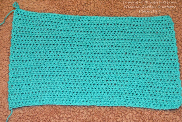 A crocheted placemat I'm working on. I need to get another skein of yarn to finish it.