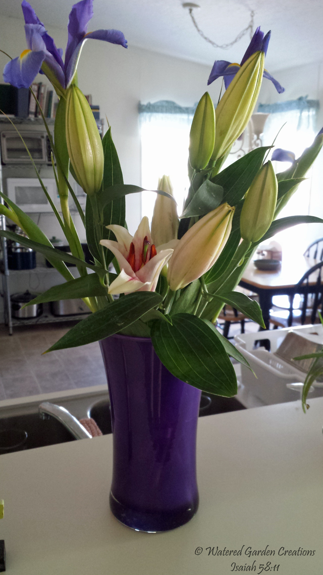 Flowers delivered from my work. The vase is thick glass and beautiful.